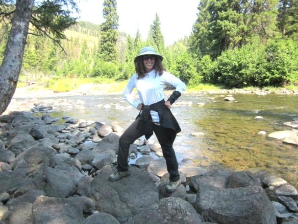 Me on rocks near river