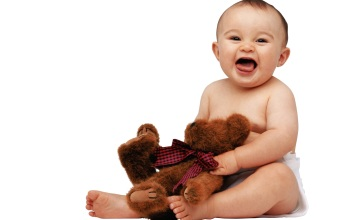 free_wallpaper_of_baby_a_cute_baby_holding_a_teddy_bear